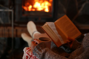 Cozied up by the fire with a book